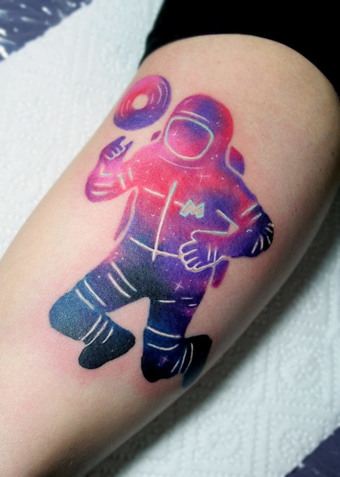 The lack of negative space and black lines in this tattoo by Giena Todryk creates a spaceman tattoo that really is out of this world!