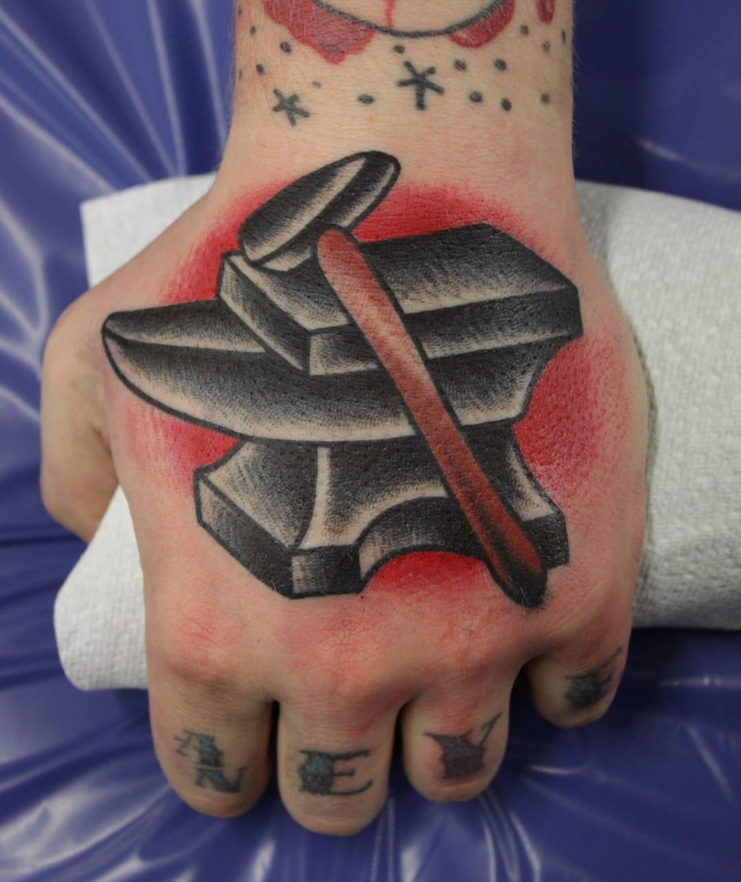 Old school anvil hand tattoo