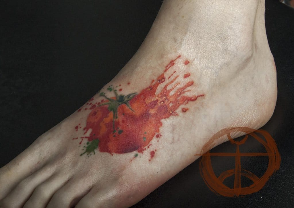 Realistic tomato tattoo by koraykaragozler