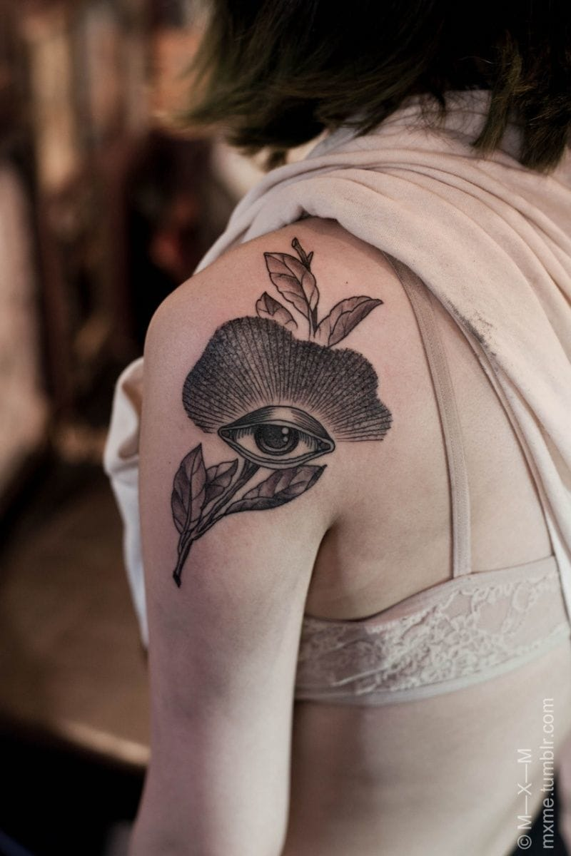 Mysterious and delicate tattoo by MXM.
