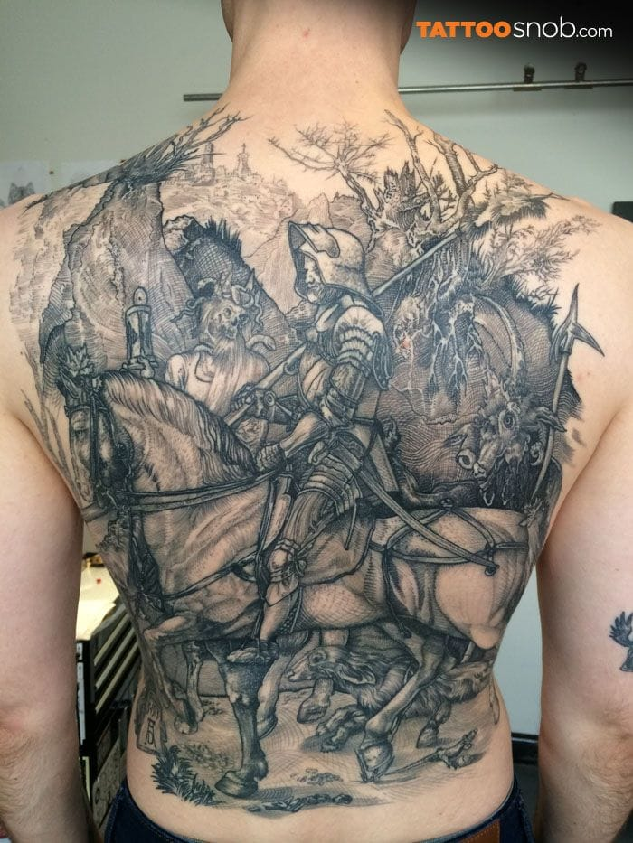 The famous engraving of Dürer, the knight and the Death, really popular among blackwork artists. Here by Kane Melbourne.
