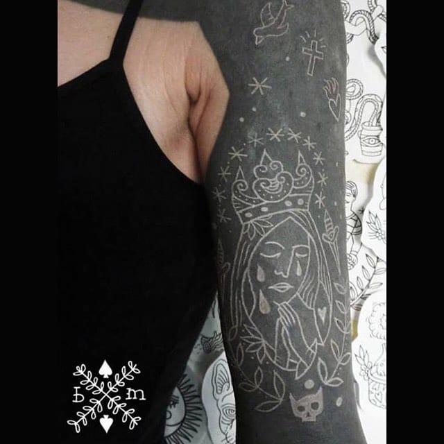 White ink on blackwork by Béatrice Myself.