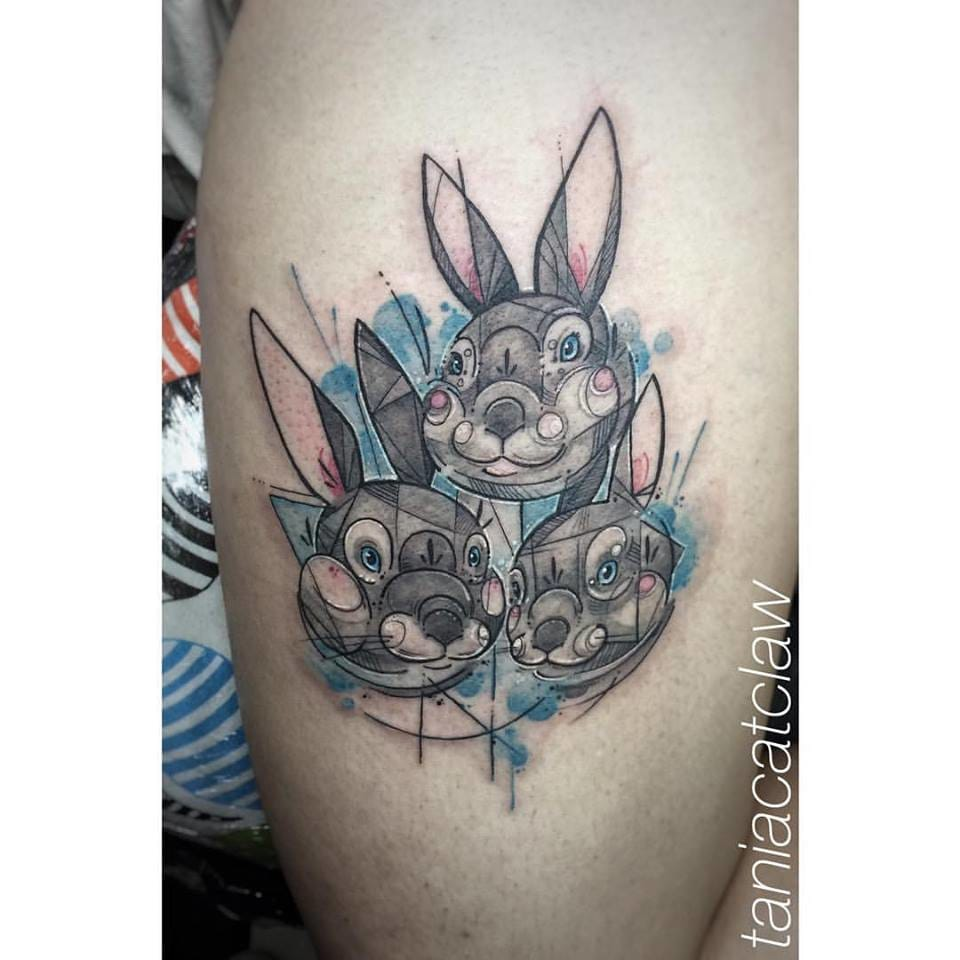 Linework and watercolor tattoo of cute bunnies...