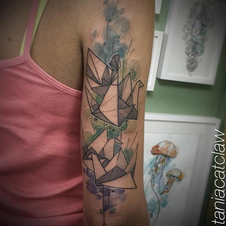 Indeed, she does a lot of poetic origami tattoos.
