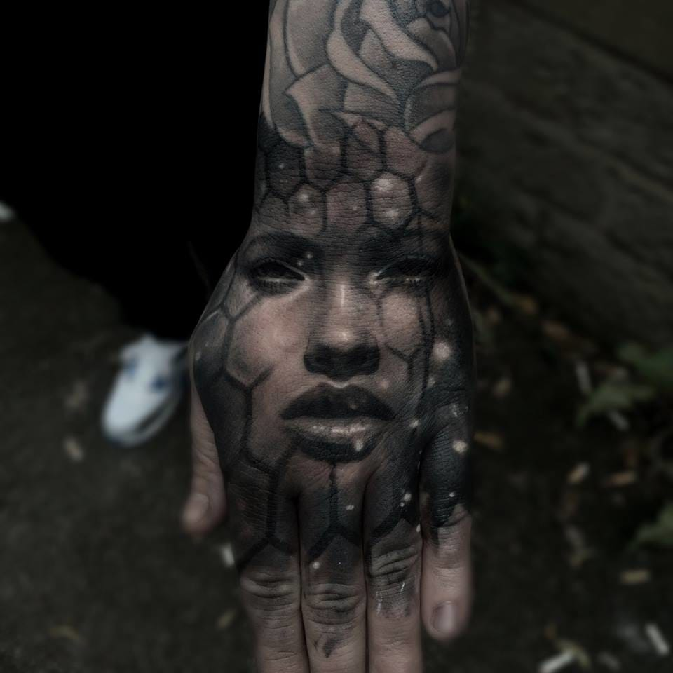 Out of this world hand tattoo...