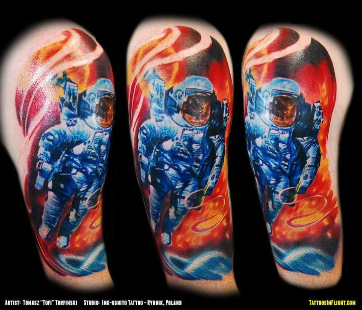Cosmonaut tattoo by Tomasz Tofi Torfinski.