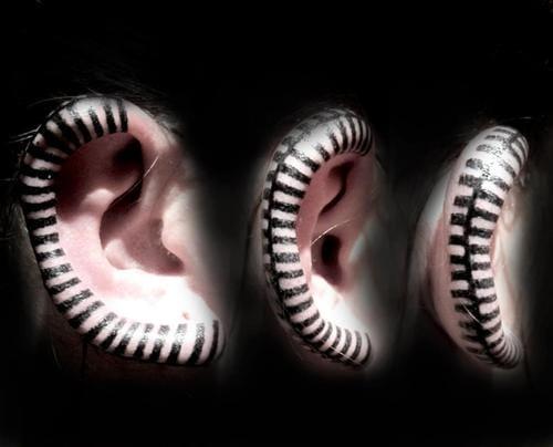 ear's edge tattoo by Delphine Noiztoy.