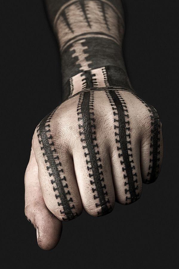 Bold hand blackwork by Nazareno Tubaro.