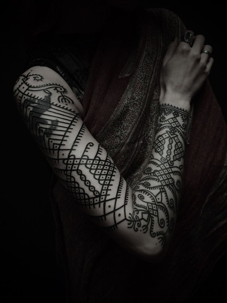 Blackwork is often inspired by tribal, here a Mehdi style tattoo by Guy Le Tatooer.