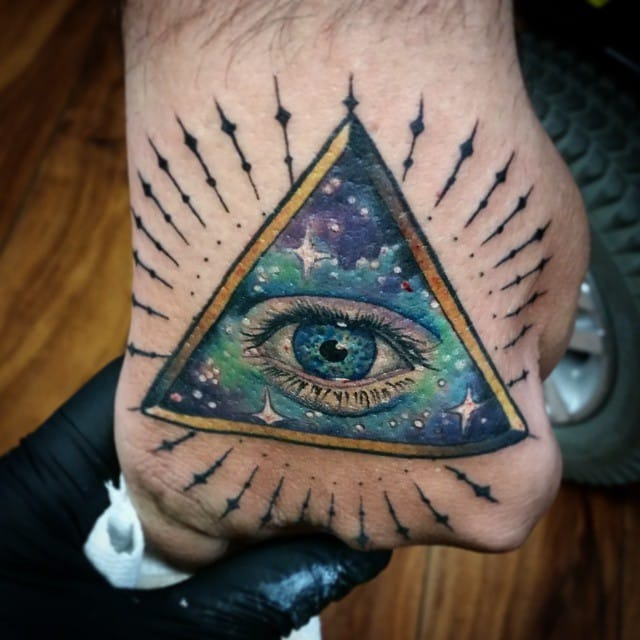 Starry hand tattoo by Anthony Ortega.