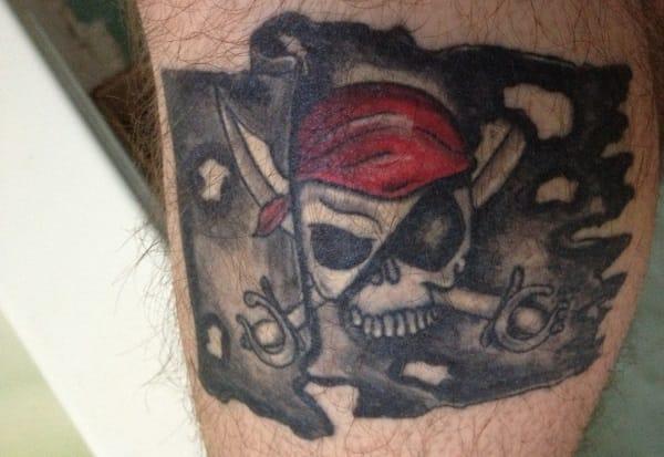 Add a badass red bandana pirate flag tattoo to it
