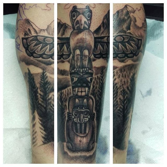 Black and Grey Totem Pole Tattoo by Paul Hallett