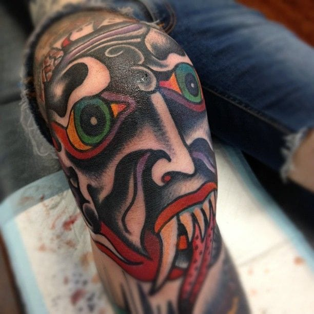 Monster head knee tattoo, by the awesome Chad Koeplinger
