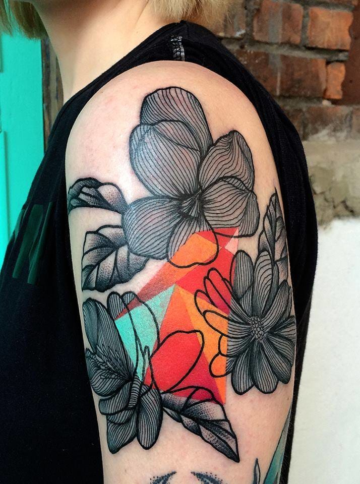 Black lines mixed with block colours in this stunning tattoo by Mariusz Trubisz. Photo credit: Redberry Tattoo Studio Facebook page.