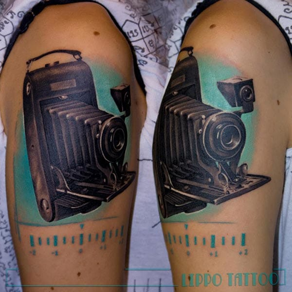 Photographers also have a weakness for camera tattoos. Here a vintage one by Lippo.