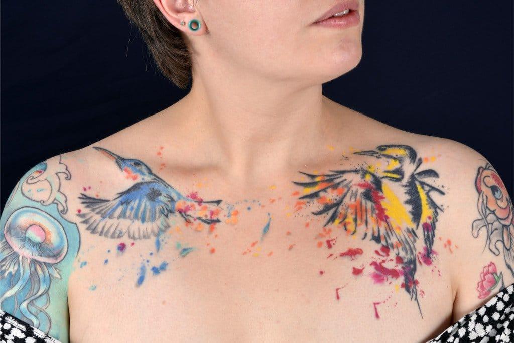 Entirely hand poked collar bone tattoos.