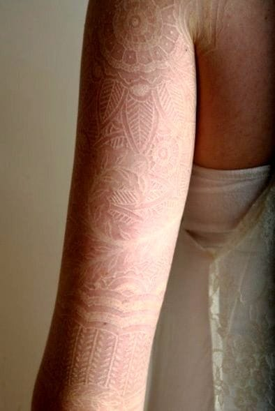 A white ink sleeve like this requires time and skill, more detail means more money.