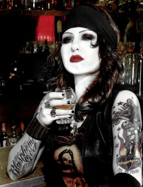 Miss B has got class sipping a brandy for a My Ruin photo shoot