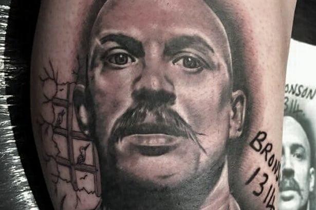 Charles Bronson Gives Award-Winning Tattoo His Approval!