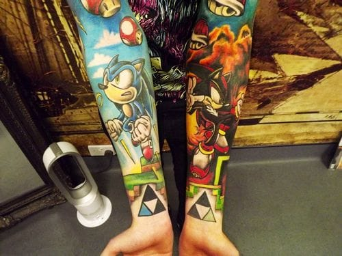 Die hard fan with full retro gaming sleeves featuring both Sega and Nintendo icons