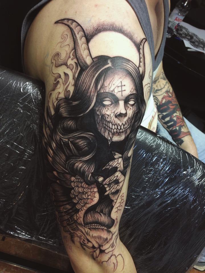 18 Salaciously Sinister Tattoos