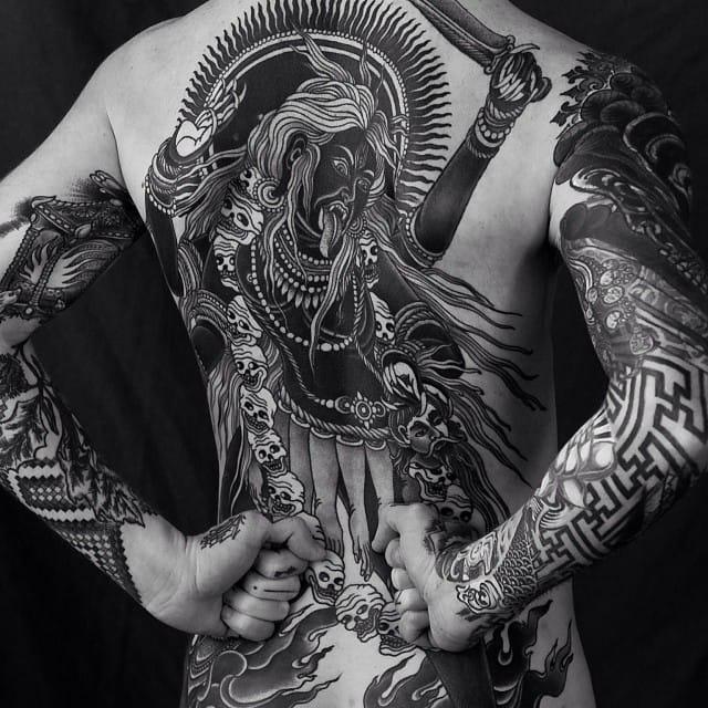 Blackwork backpiece by Alexander Grim.
