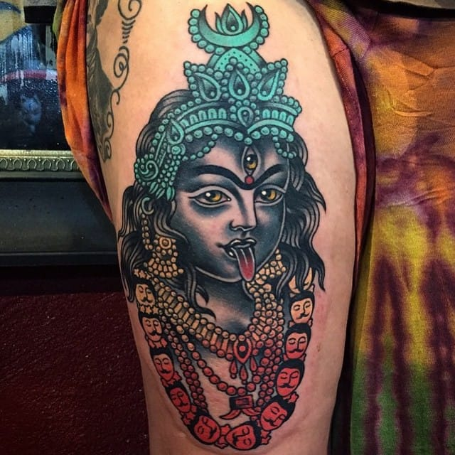 Colorful tattoo by Phil Hatchet-Yau.