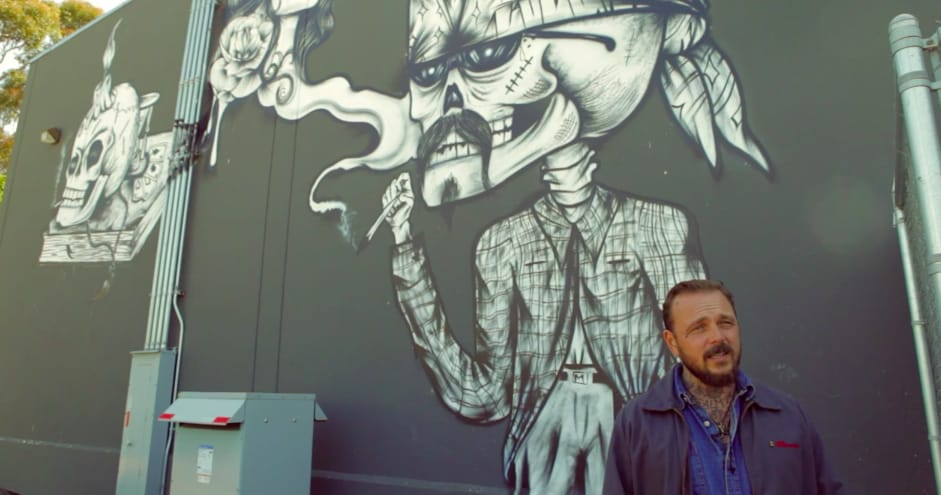 Marcus Kuhn by a San Diego mural.