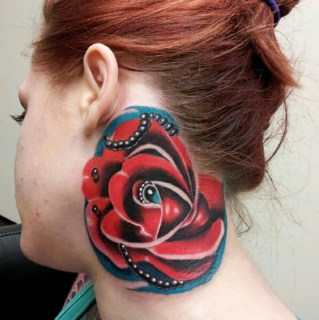 Beaded red rose tattoo by Kip Jones, Las Vegas. Photo from Instagram @tattoosbykipjones.