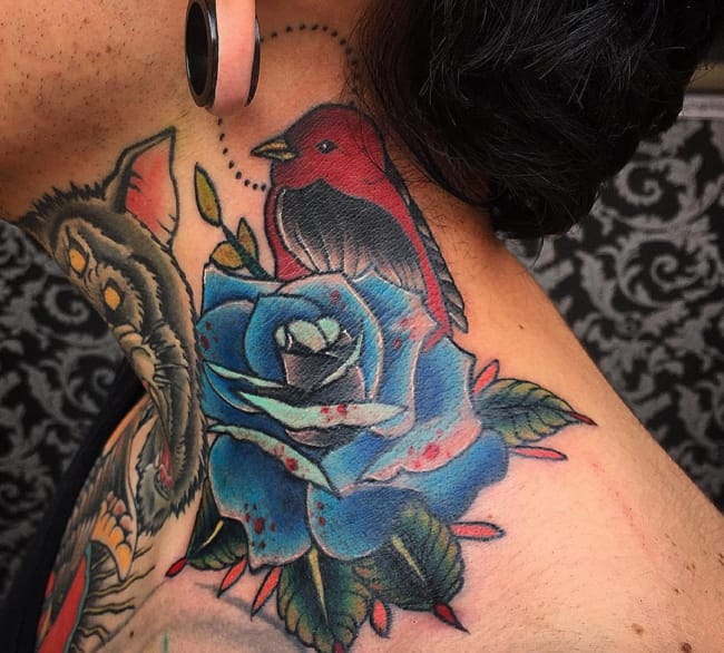 Blue rose tattoo by Tono Rogers, Mexico. Photo from Instagram @tonorogers.