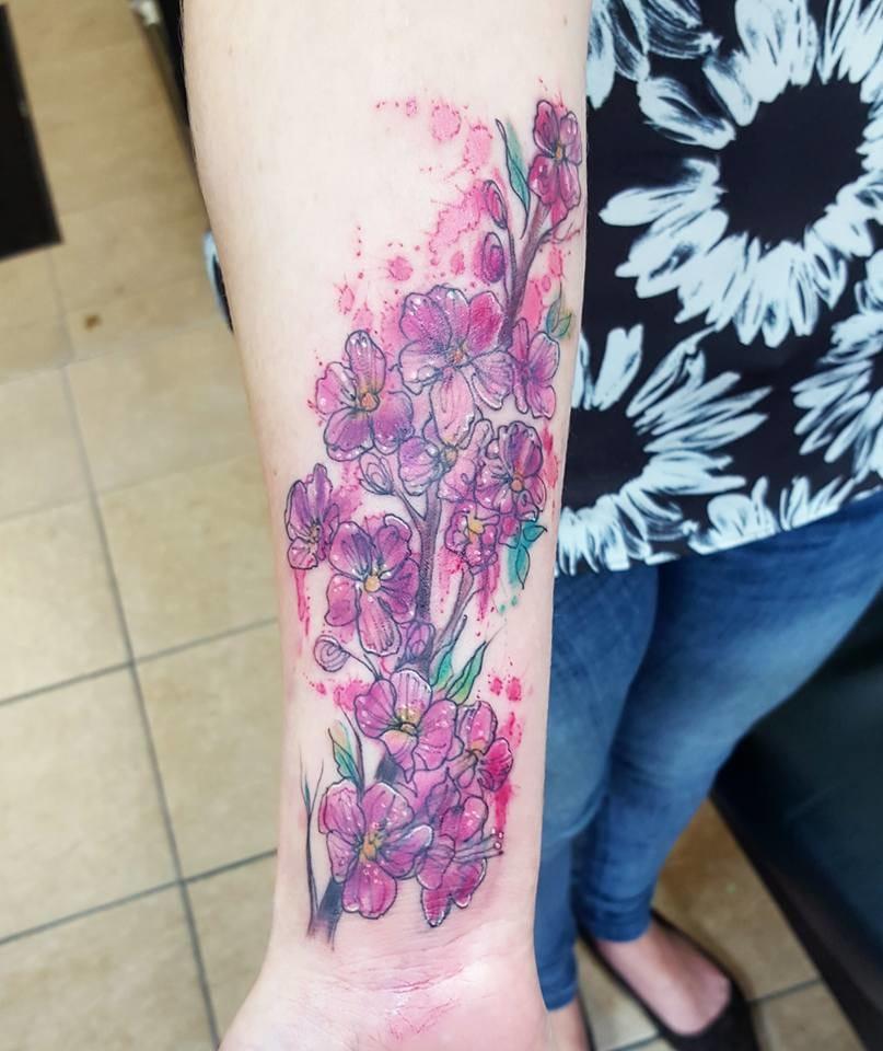 Cherry blossom tattoo. Photo from Joanne's Instagram @milky_tattoodles.