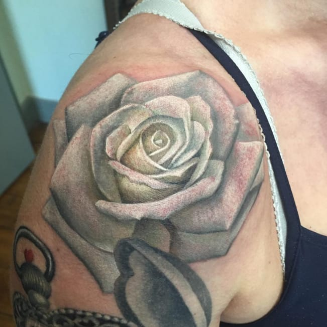 White rose tattoo by Bethany Rivers, Sunderland, UK. Photo from Instagram @bethanyriverstattoos.