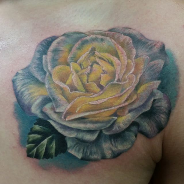 White rose tattoo by Cassie Eisenhour. Photo from Instagram @cassieeisenhour.