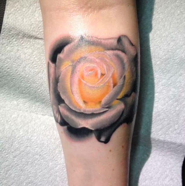 White rose tattoo by Lynden Chadwick, Halifax Tattoo Collective, West Yorkshire, UK. Photo from Instagram @lyndenchadwicktattoo.