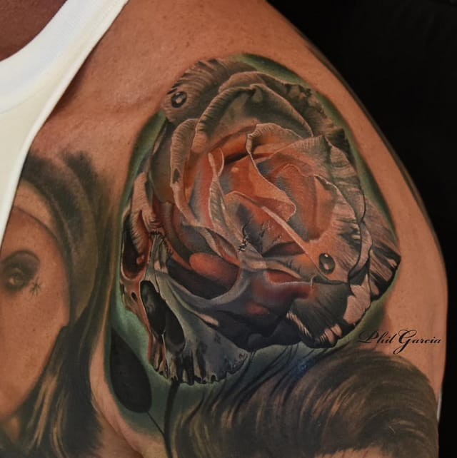 White rose and skull tattoo by Phil Garcia - Instagram @philgarcia805.
