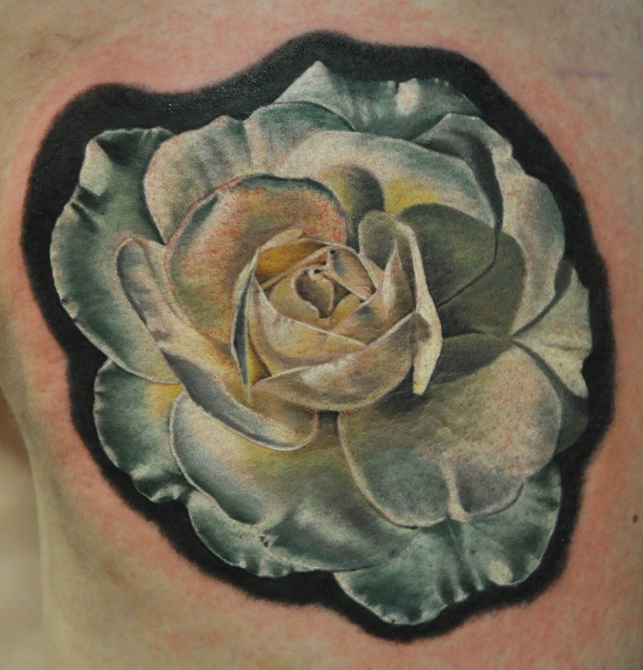 White rose tattoo by William Jones, Nebula Tattoo, South Wales, UK. Photo from Instagram @nebulatattoo.