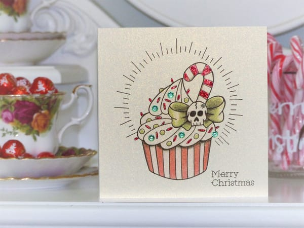 Candy cane cupcake tattoo design on Christmas card, by Vicki Ashurst.