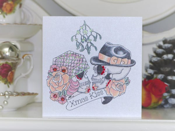 Mistletoe sugar skulls Christmas kiss tattoo design, by Vicki Ashurst.