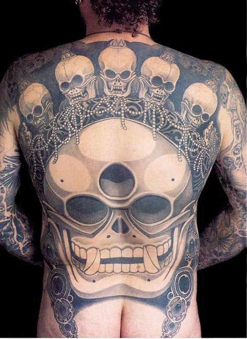Asian influenced-black and gray: skulls and beads adorning Third Eye Skull by Filip Leu