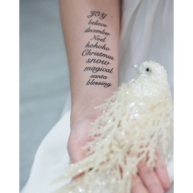 Magical xmas words tattoo, Source: Instagram @etheldred4