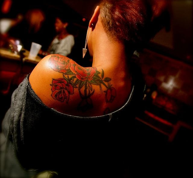 Another delicate rose tattoo.