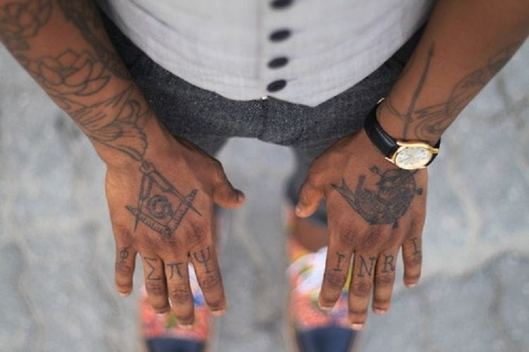Great hand tattoos with some Massonic symbols. Badass!