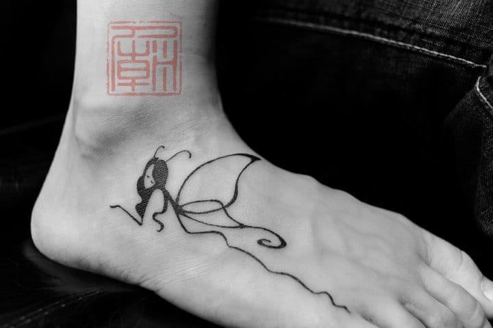 Minimalistic tattoo by Joey Pang.