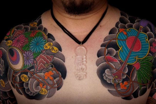 Bold Japanese Chest Tattoo by Horiyasu Tattoo