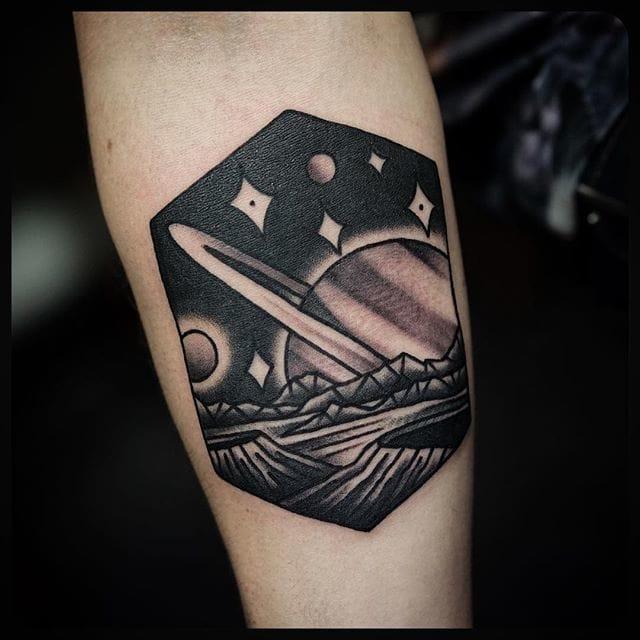 Bold Saturn Tattoo by Philip Yarnell