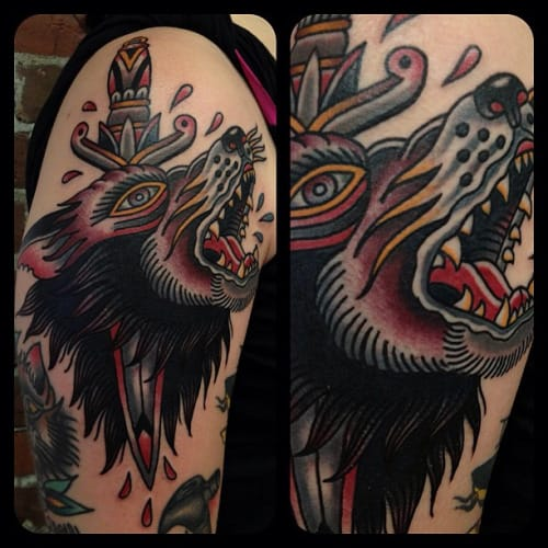 18 Dynamic Wolf Dagger Tattoos
