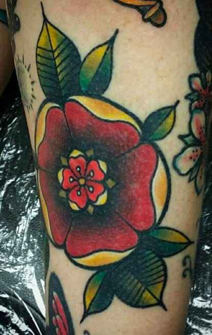 Bright tudor rose by Ellis Arch Nala, Tamworth, UK. Photo from Instagram @ellisarchtattoo