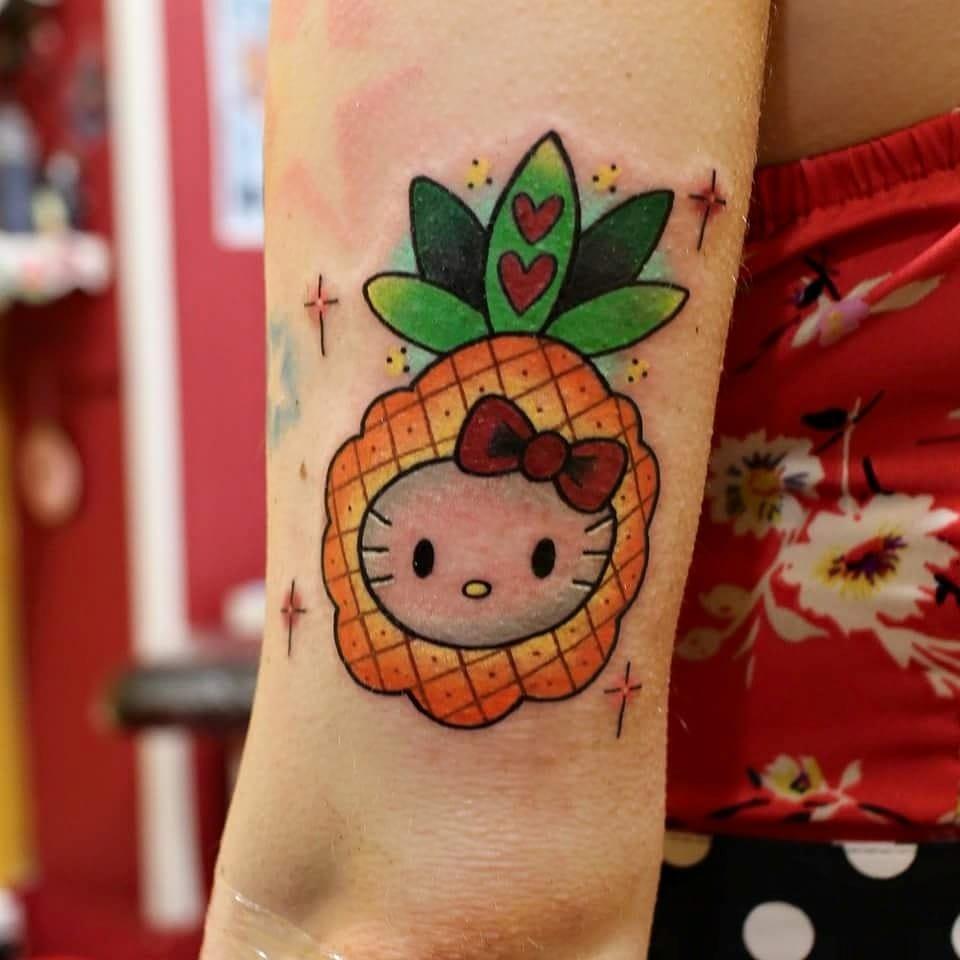Pineapple Hello Kitty tattoo