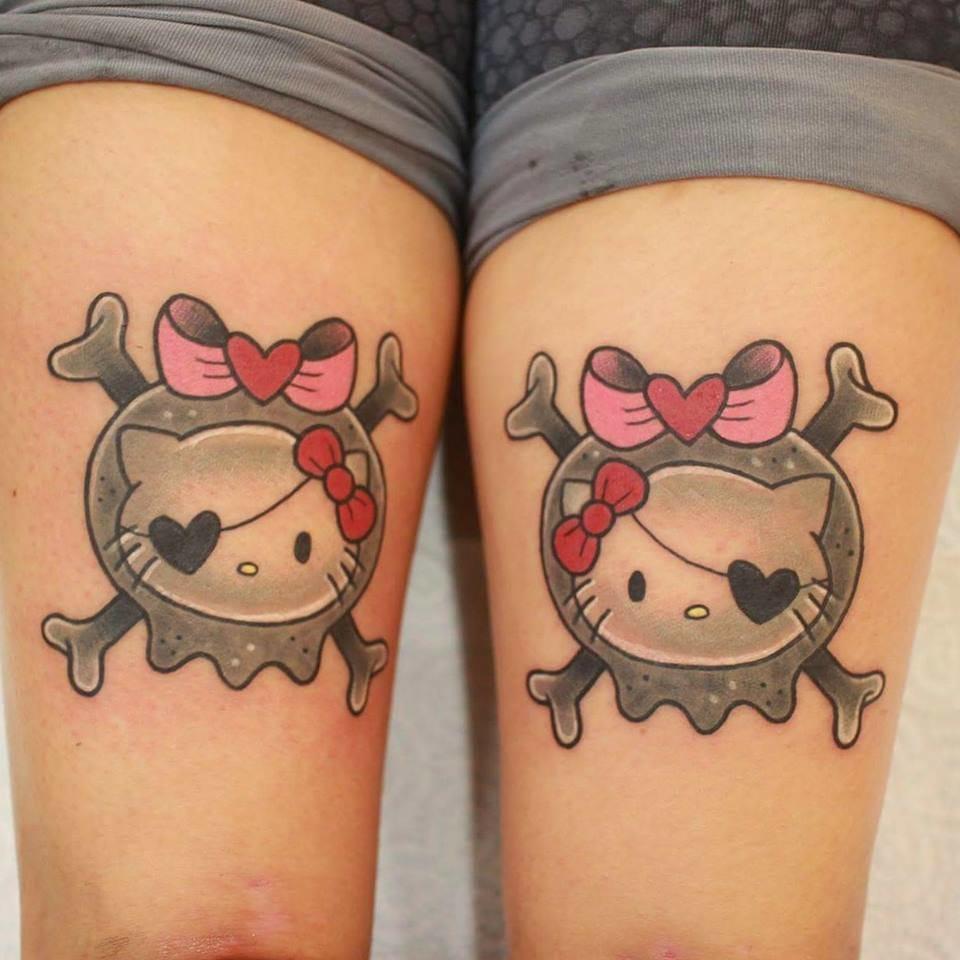 Matching Hello Kitty skull tattoos