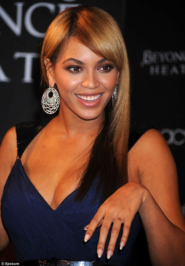 Beyonce's IV tattoo on her wedding finger